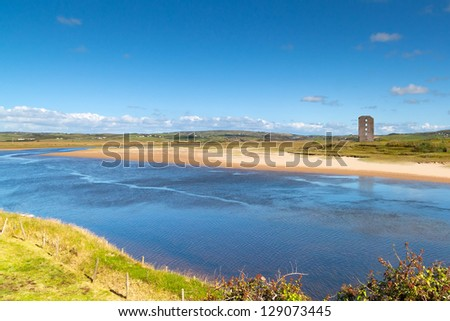 River view with ruins of Dough Castle in Lahinch, Co. Clare, Ireland
