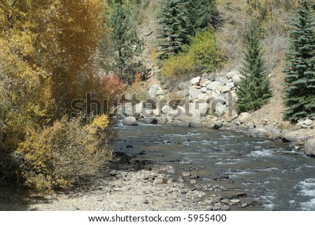 River with autumn trees - stock photo