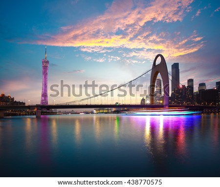 River with modern city landmark architecture backgrounds of pink clouds in Guangzhou China - stock photo