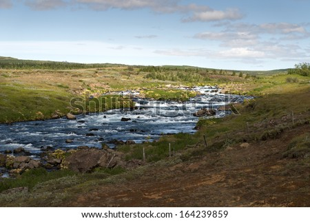 river with rapids near Gullfoss in Iceland