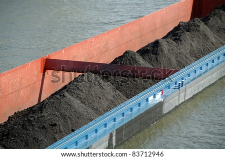 Riverboat fragment with coal - stock photo