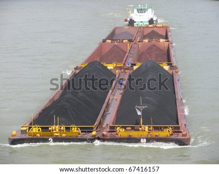 Riverboat with coal - stock photo