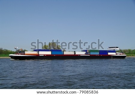 Riverboat with containers - stock photo