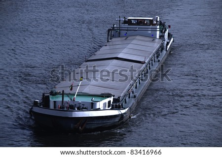 Riverboat with goods at night - stock photo