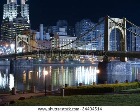 Riverfront park with graceful bridge in Pittsburgh Pennsylvania. - stock photo