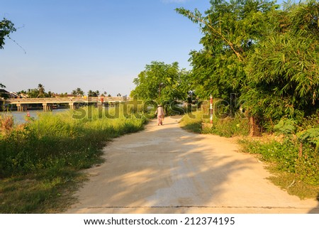 Riverside bucolic scenery of Thu Bon River, Hoi An, Quang Nam, Vietnam. Hoi An is recognized as a World Heritage Site by UNESCO. - stock photo