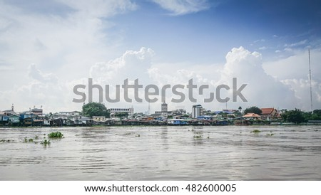 Riverside Community Chao Phraya River in Bangkok with the beautiful sky