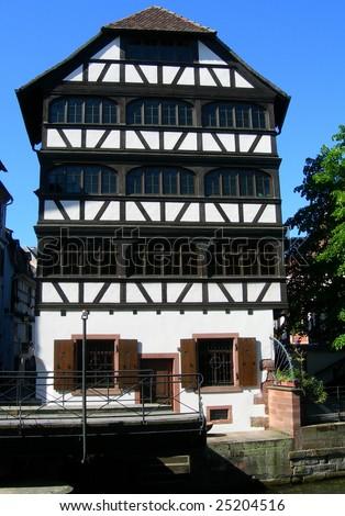 Riverside home in old historic center of Strasbourg, France - stock photo