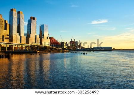Riverside neighborhood in New York City at sunset - stock photo
