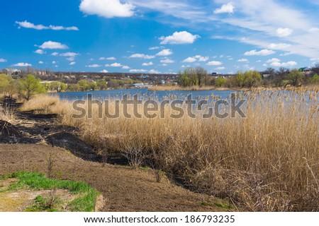 Riverside of small Ukrainian river Sura at early spring season - stock photo