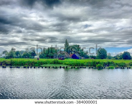 stock-photo-riverside-under-a-dramatic-s