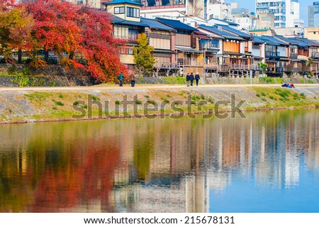 riverside with autumn colored leaves in kyoto - stock photo