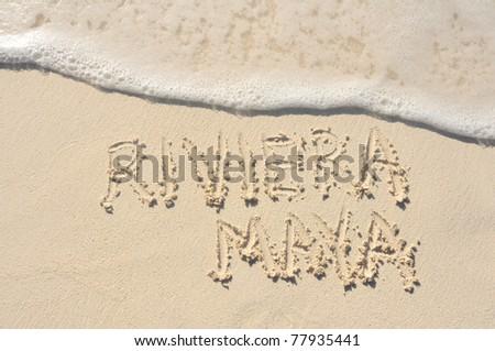 Riviera Maya Written in the Sand on a Beach - stock photo