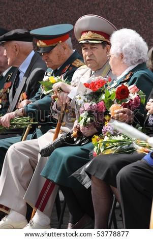 RIVNE, UA - MAY 9 : soviet veterans celebrate Victory Day May 9, 2010 in Rivne, Ukraine - stock photo