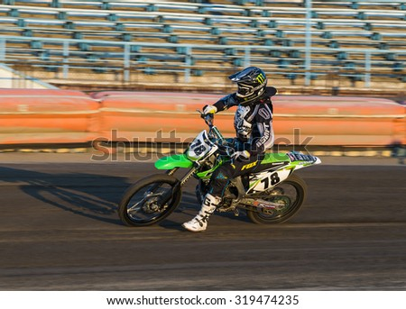 Rivne, Ukraine - 29 August 2015: Unknown rider prepares for the start at the Open Cup Speedway to the day of the city Rivne - stock photo