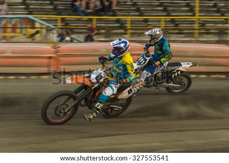 Rivne, Ukraine - 29 August 2015: Unknown riders overcomes the track at the Open Cup Speedway to the day of the city Rivne - stock photo