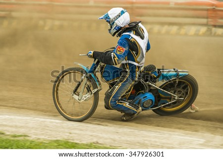 Rivne, Ukraine - 11 October 2015: Unknown rider overcomes the track at the Open Cup Speedway to the day of the city Rivne