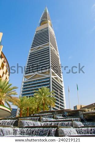 RIYADH - DECEMBER 22: Al Faisaliah tower facade on December 22, 2009 in Riyadh, Saudi Arabia. Al Faisaliah towers is a luxury hotel and the most distinctive skyscraper in Saudi Arabia - stock photo