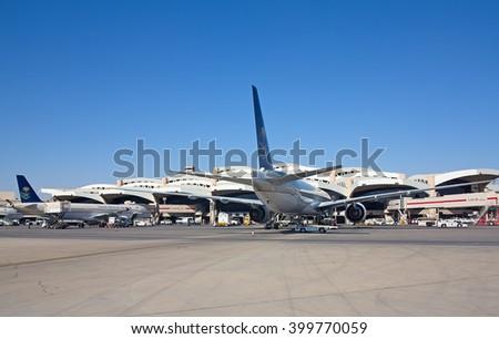 Riyadh - March 01:  Planes preparing for take off at Riyadh King Khalid Airport on March 01, 2016 in Riyadh, Saudi Arabia. Riyadh airport is home port for Saudi Arabian Airlines. - stock photo
