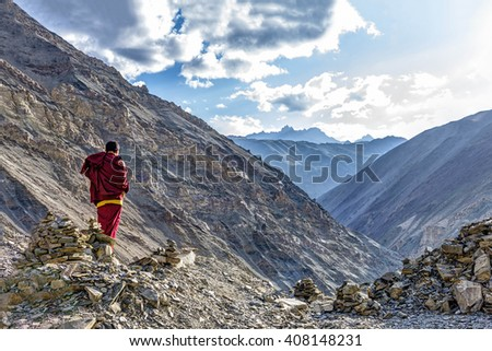 Rizong, India - August 17, 2015: View of buddhist monk in meditation over the Rizong monastery gorge. Rizong monastery is situated at the top of a rocky side valley on the north side of the Indus. - stock photo