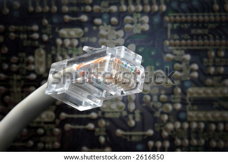 rj45 plug macro shoot with electronic board on background - stock photo