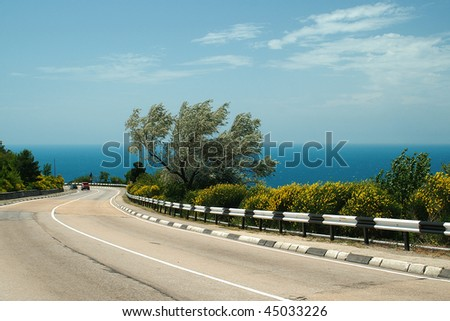 Road about the sea in the south of Ukraine - stock photo