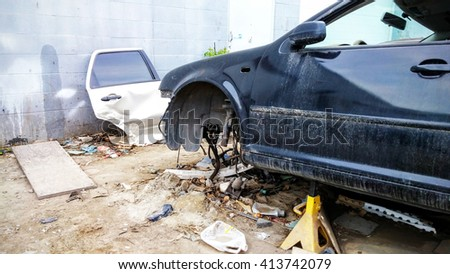 Road accident crash damaged car or wreck broken vehicle - stock photo