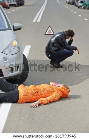 Road accident. Knock down pedestrian and upset driver in front of automobile crash car collision - stock photo