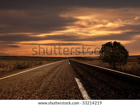 Road ahead and the sunset - stock photo