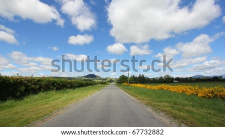 Road ahead on a cloudy day - stock photo