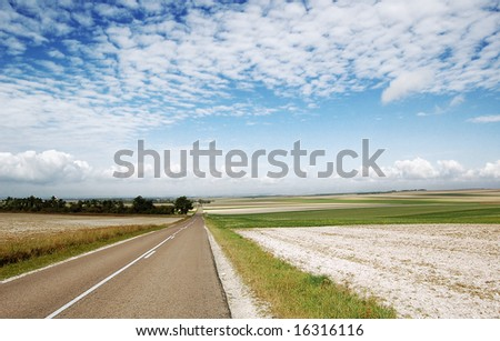 road along agriculture field - stock photo