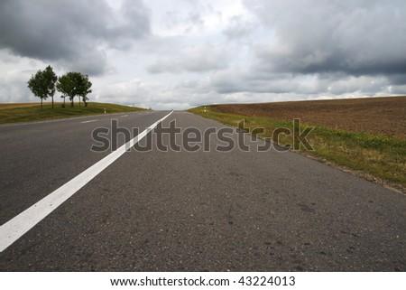 Road among fields. - stock photo