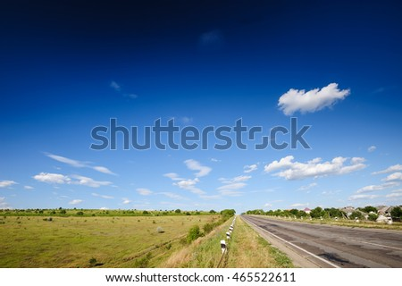 Road and agricultural fields, typical landscape in Republic of Moldova