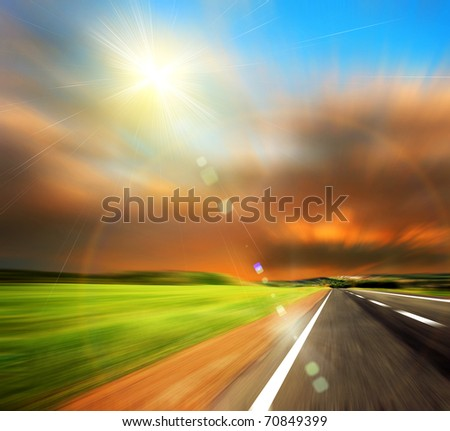 road and blured sky with sun - stock photo