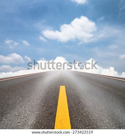 road and clouds on blue sky