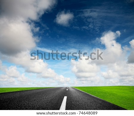 Road and cloudy sky - stock photo