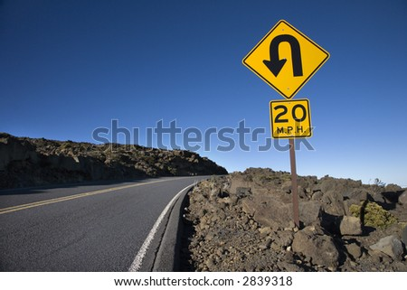 Road and curve in road sign in Haleakala National Park, Maui, Hawaii. - stock photo