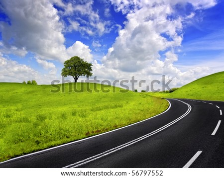 Road and green field - stock photo