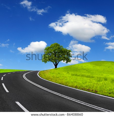 Road and green landscape - stock photo