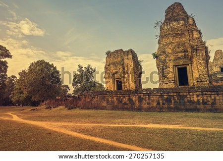 Road and old temple Pre Rup on sunrise , Angkor, Siem Reap, Cambodia - stock photo