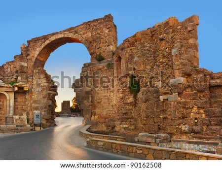 Road and ruins in Side, Turkey at sunset - archeology background - stock photo