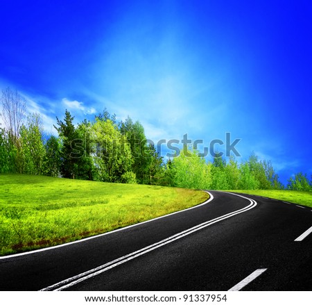 Road and spring landscape - stock photo