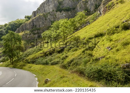 road and steep slopes at Cheddar gorge, Somerset landscape of the famous touristic narrow valley with the road  that bends amongs the cliffs  - stock photo