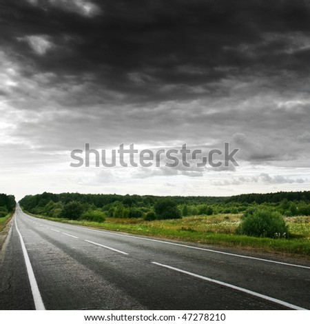 Road and stormy sky. - stock photo