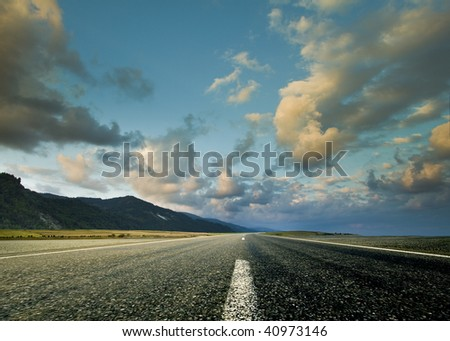 Road and the dramatic sky with strong perspective - stock photo