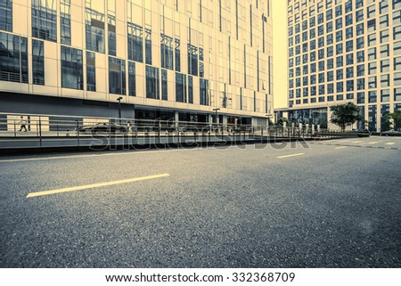 road and the morden office building - stock photo