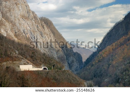 Road and tunnel in mountain gorge