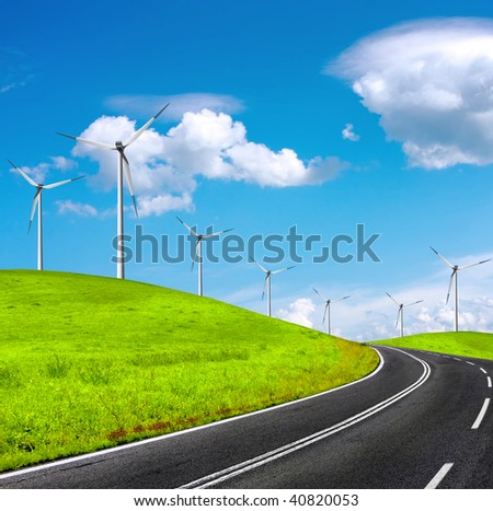 Road and wind turbines on green field