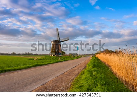 Road and windmill, traditional Holland landscape