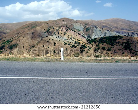 road asphalt and hill - stock photo
